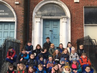 The Ark's Artist in Residence Shaun Dunne with children from Colaiste Mhuire as part of our 2019 Neighbourhood Project resulting in the short film Iarscoláire