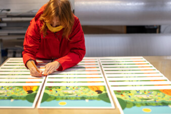 Fuchsia MacAree signing prints of 'Like The Sun Coming Out'